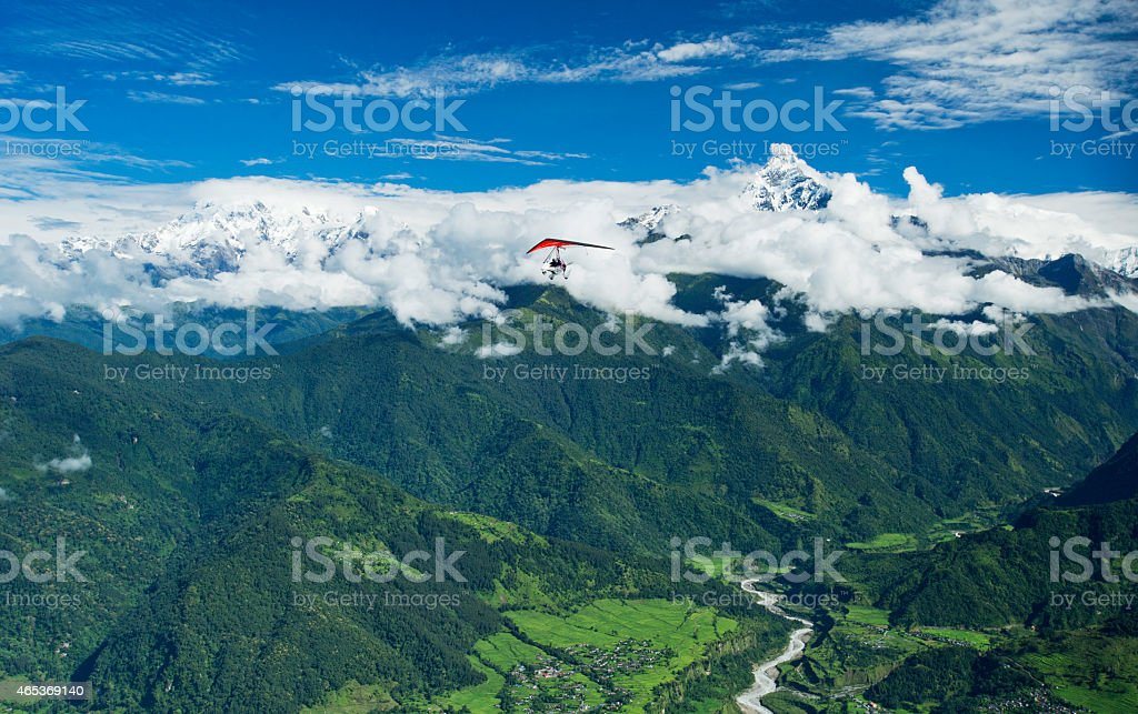The motor hang-gliding in the sky - Nepal stock photo