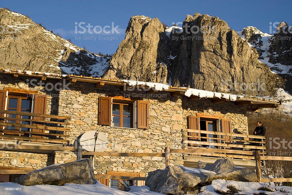 The mountain hut at sunrise royalty-free stock photo