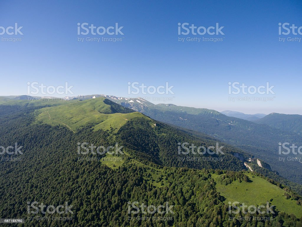The mountain ridge covered  forest. Mountain landscape. stock photo