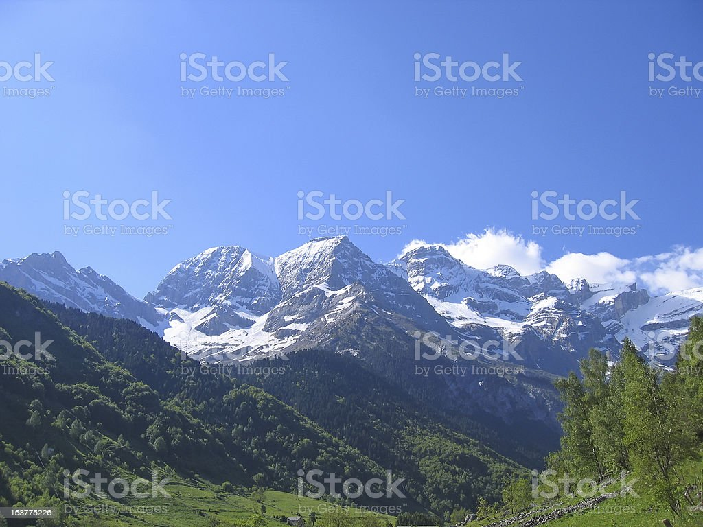 The mountains around gavarnie circus with forest in foreground stock photo
