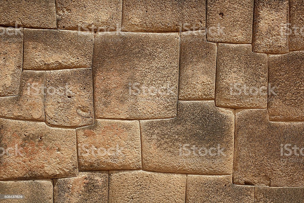 The multi-sided granite stones in ancient Inca wall street royalty-free stock photo
