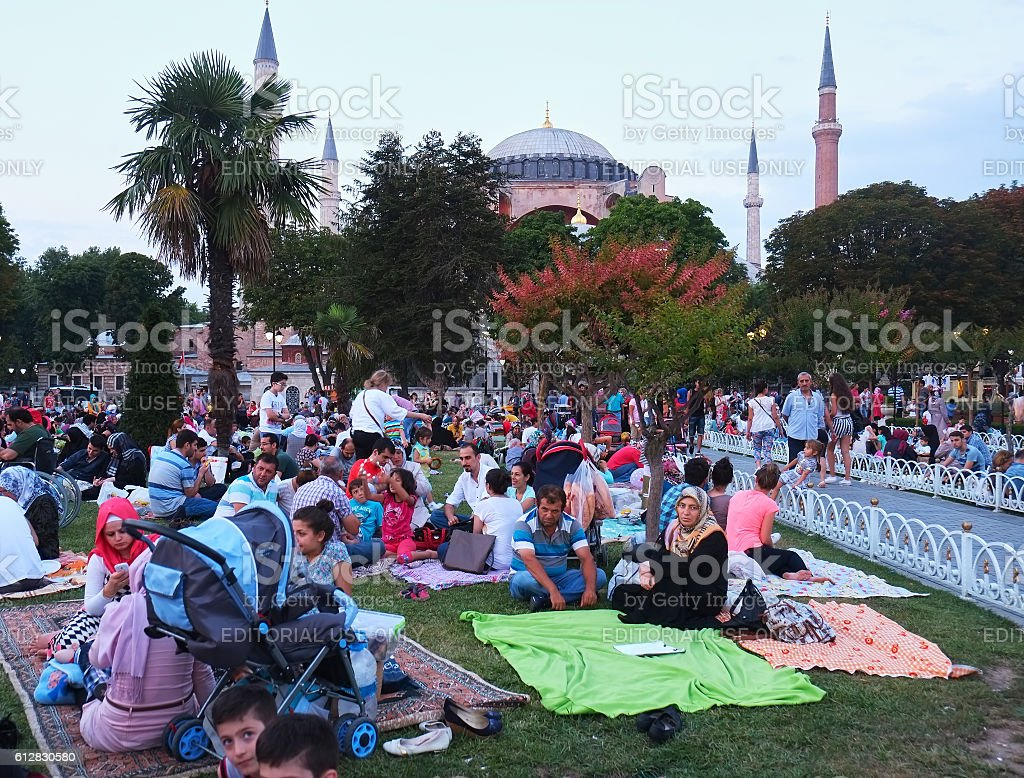 The Muslims waiting for the evening meal (Iftar) in stock photo