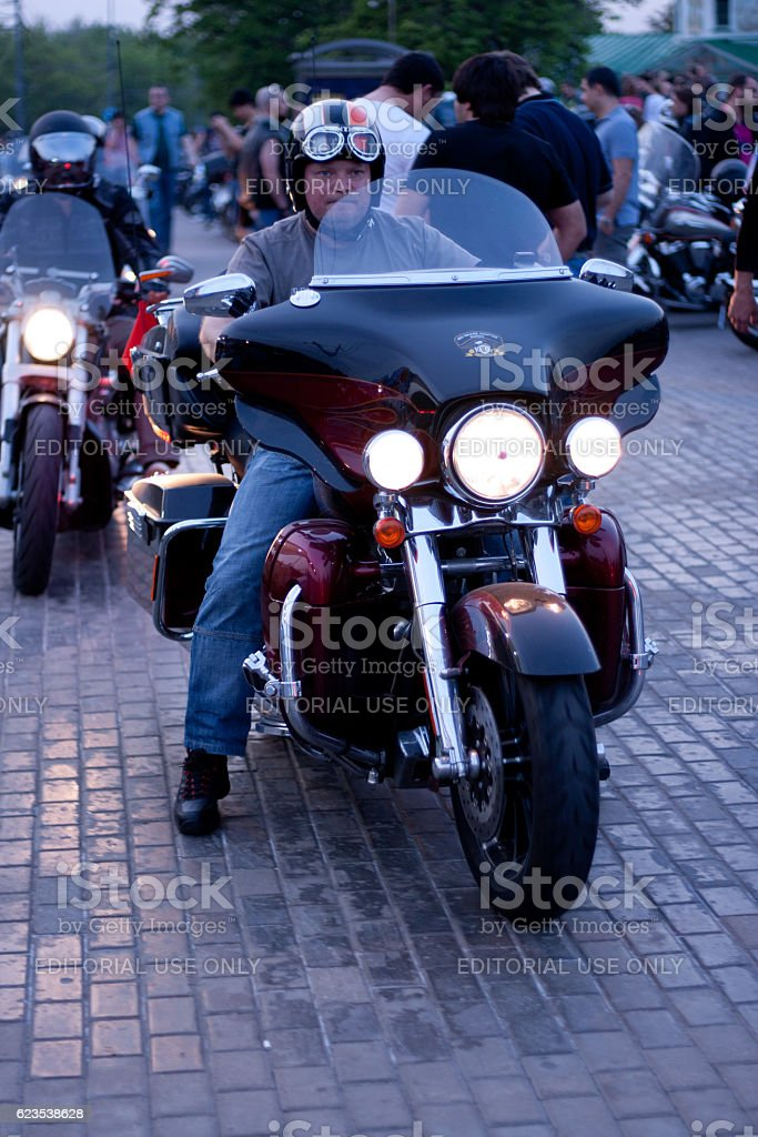 The mustachioed man in a helmet on a motorbike Harley-Davidson stock photo