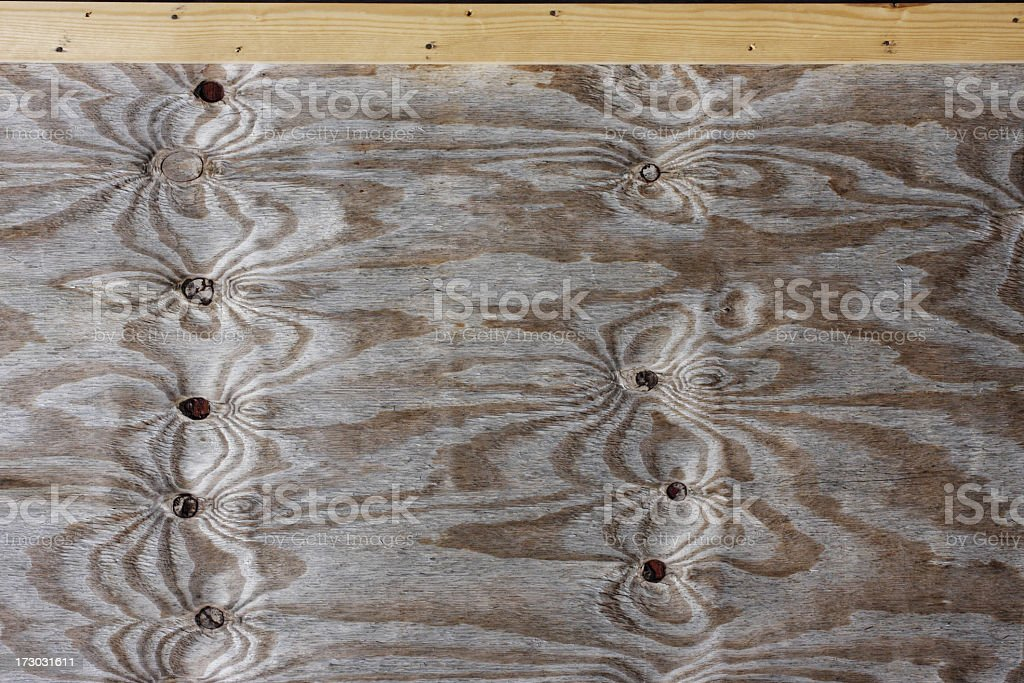 Wood pattern nails swirling whorls and header board stock photo