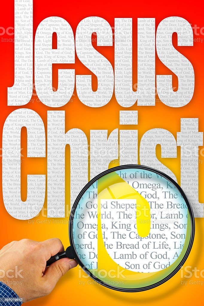 The name Jesus Christ under observation with magnifying glass stock photo