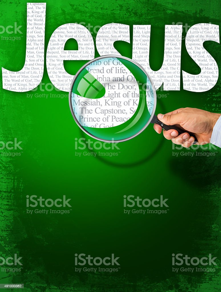 The name JESUS under observation with magnifying glass stock photo