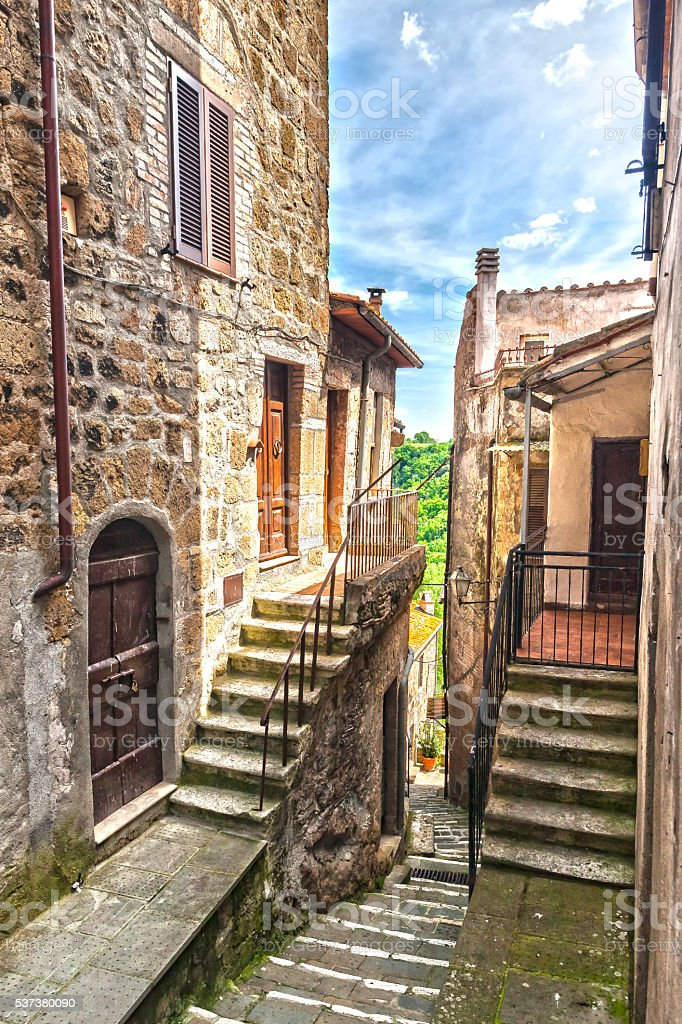 The narrow street of the old city in Italy stock photo