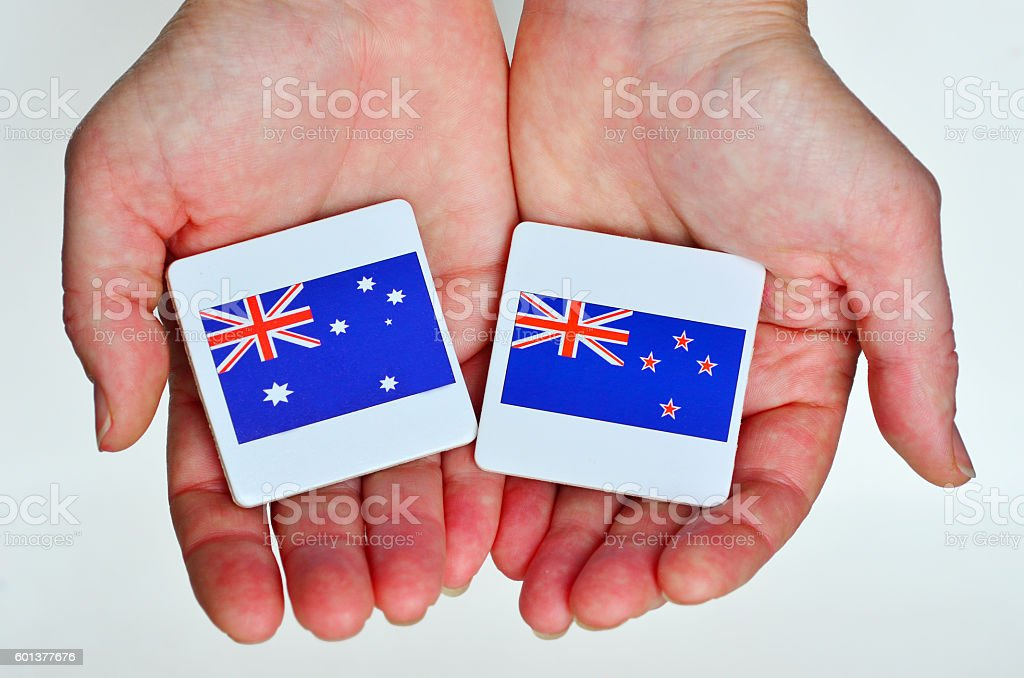 The national flags of Australia (R) New Zealand stock photo