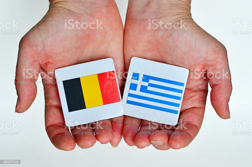 The national flags of Germany (L) and Greece (R) stock photo