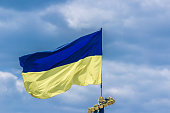 The national yellow and blue flag of Ukraine over the
