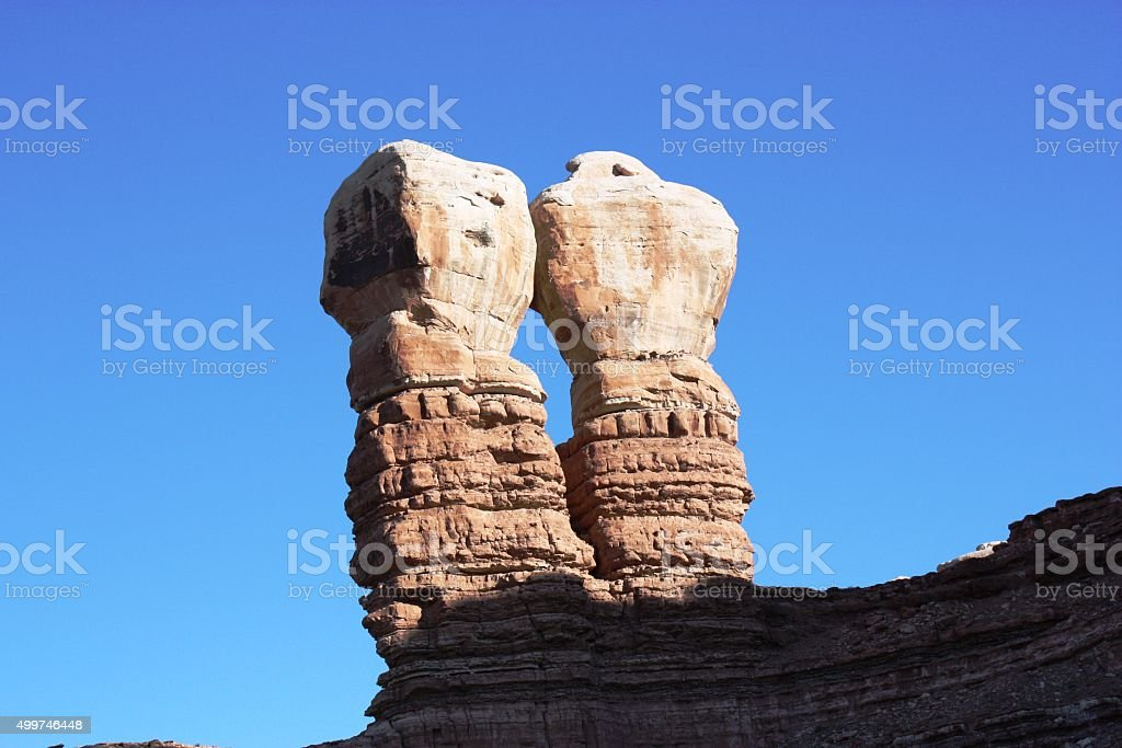 The Navajo Twin Rocks under blue sky in Bluff, USA stock photo