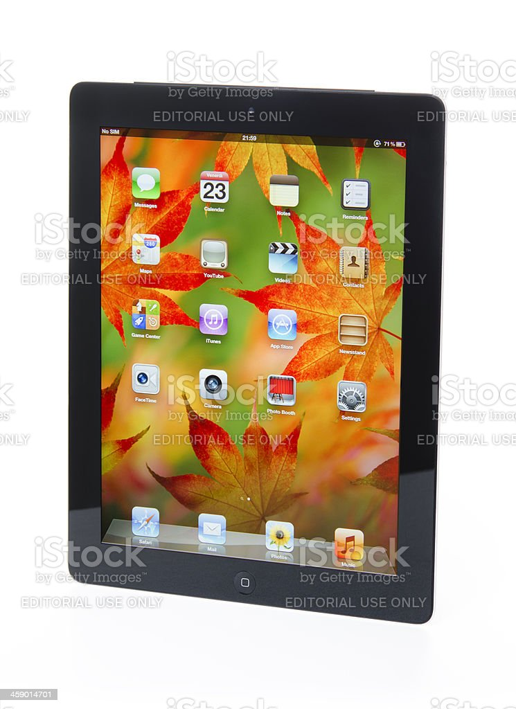 The new Apple Ipad 3 black reflecting on a table stock photo