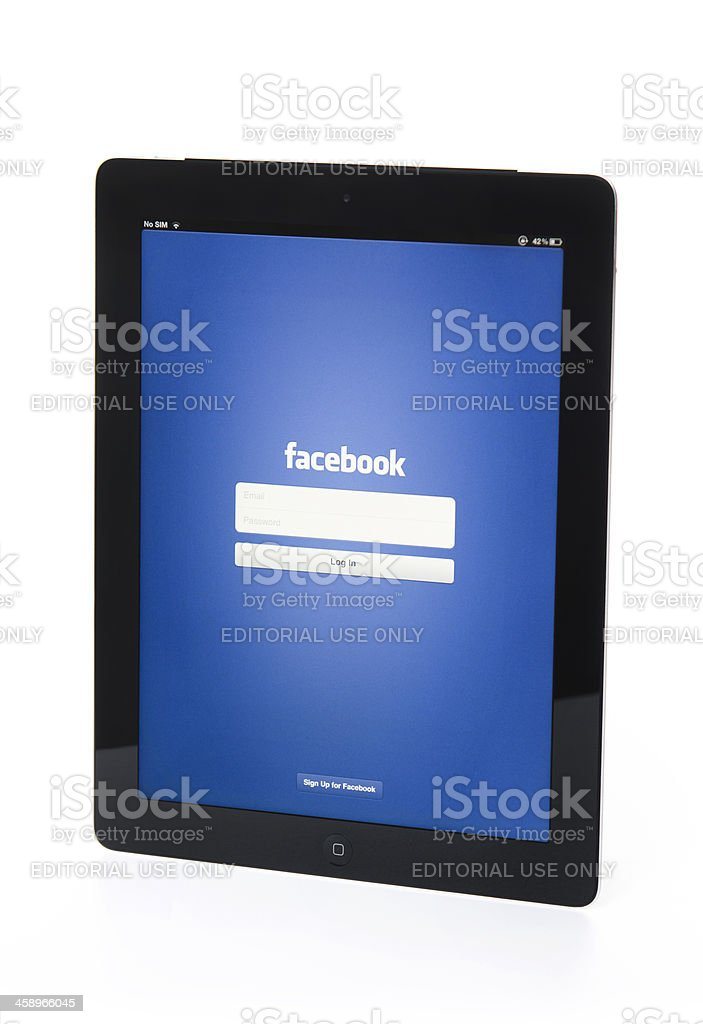 The new Apple Ipad 3 black with Facebook app royalty-free stock photo