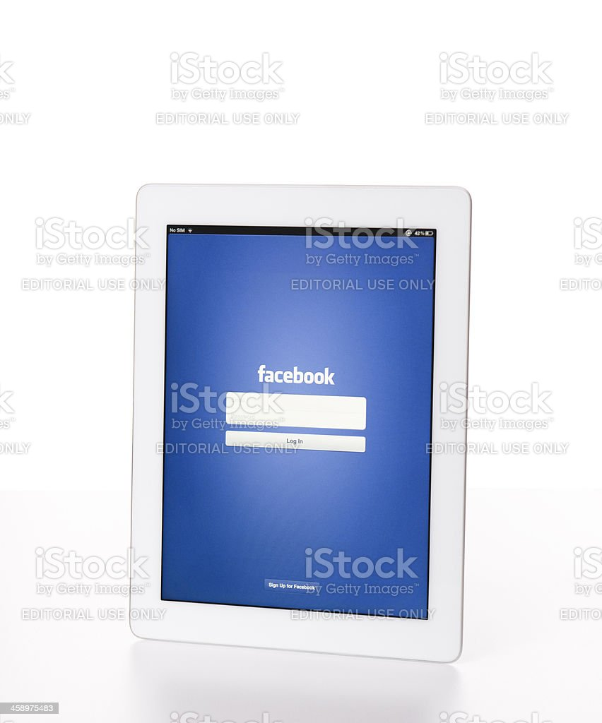 The new Apple Ipad 3 white with Facebook app royalty-free stock photo