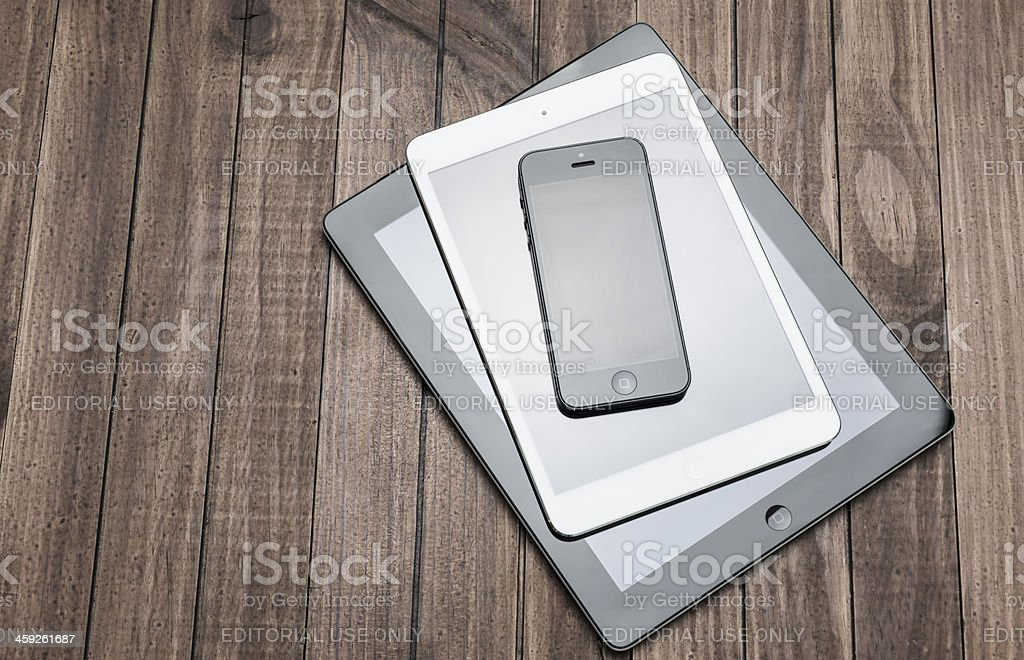 The new devices :  iphone, ipad, ipadmini royalty-free stock photo