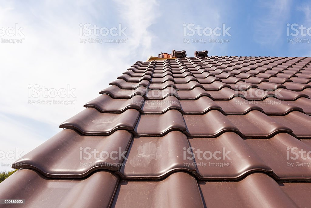 The new roof of red tiles. stock photo