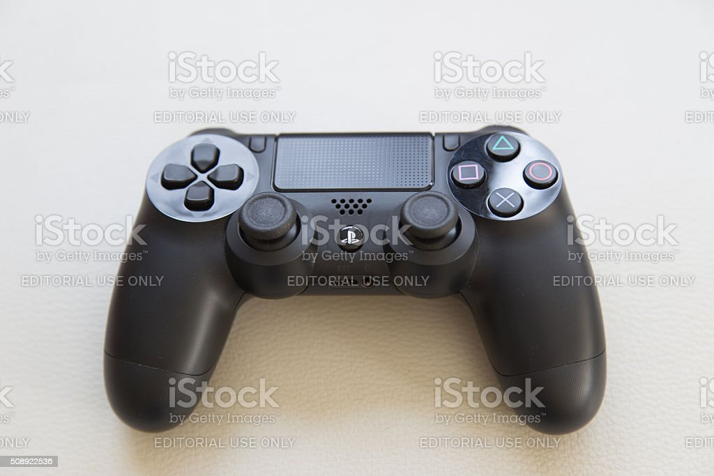 The new sony dualshock 4 red and black color controller stock photo