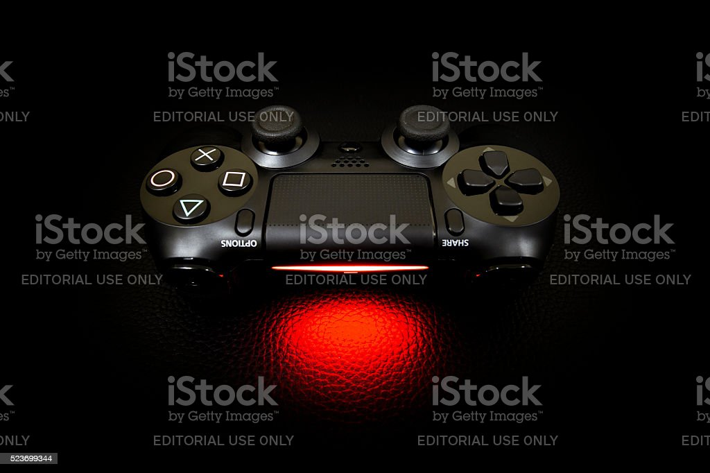 The new Sony Dualshock 4 with PlayStation 4 stock photo
