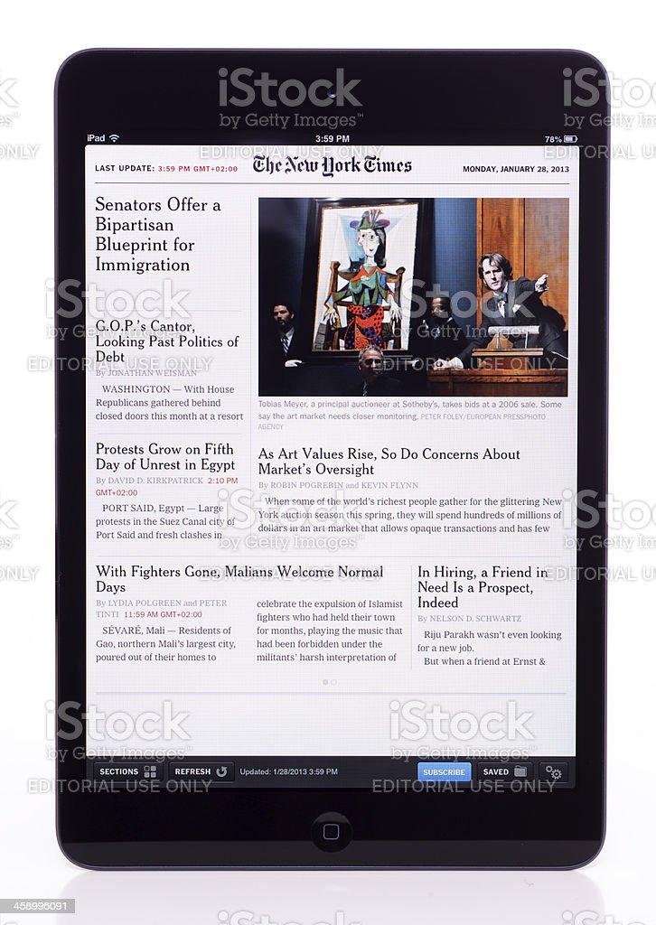 The New York Times on iPad Mini royalty-free stock photo