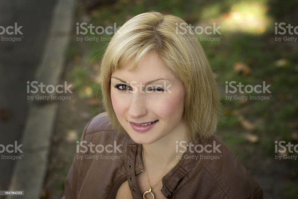 The nice girl winks royalty-free stock photo