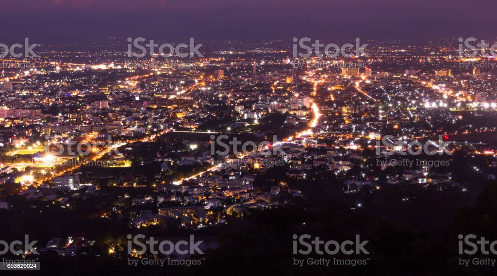 the night light of Chiangmai city, Thailand view from mountain in twilight period stock photo