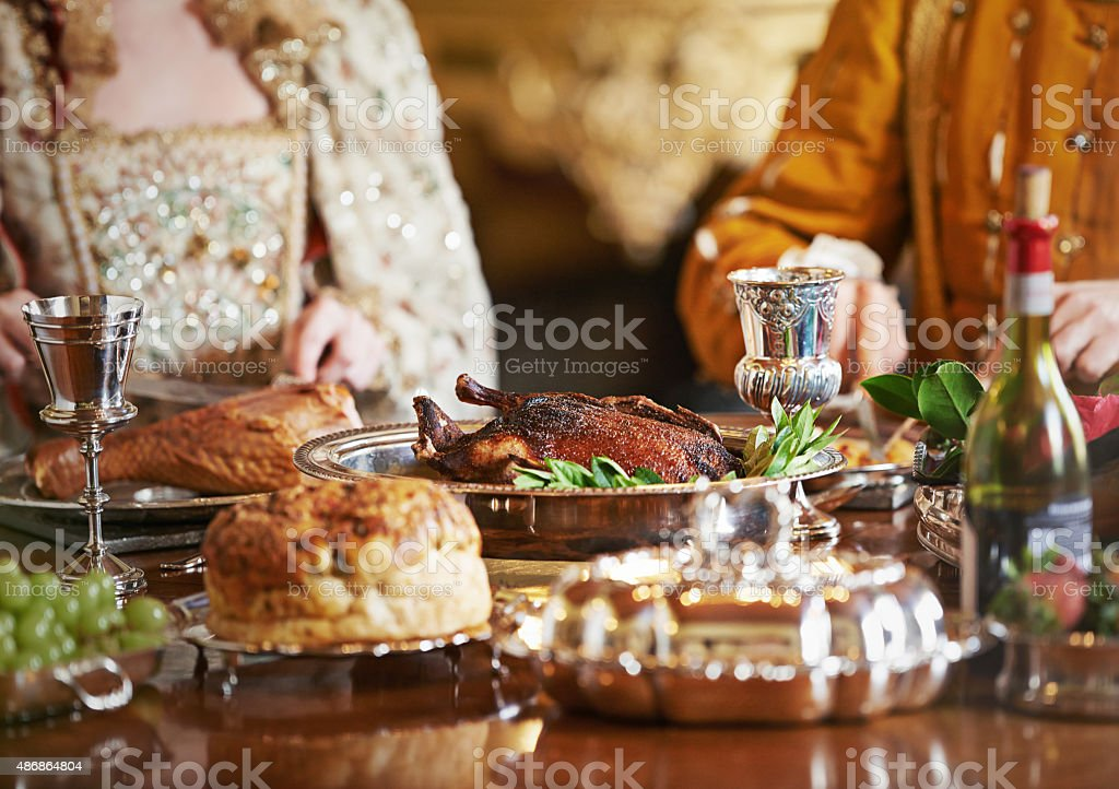 The nobility feasts while the people hunger stock photo