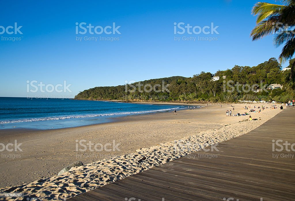 The Noosa Main Beach with the wooden Boardwalk stock photo