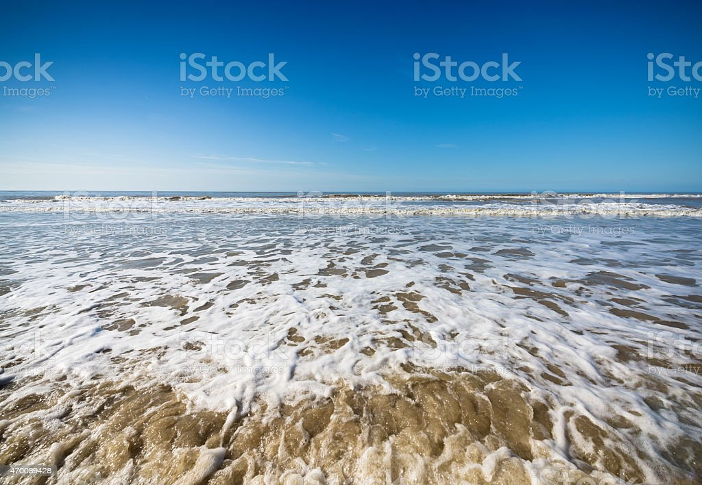 The North Sea with a blue sky stock photo
