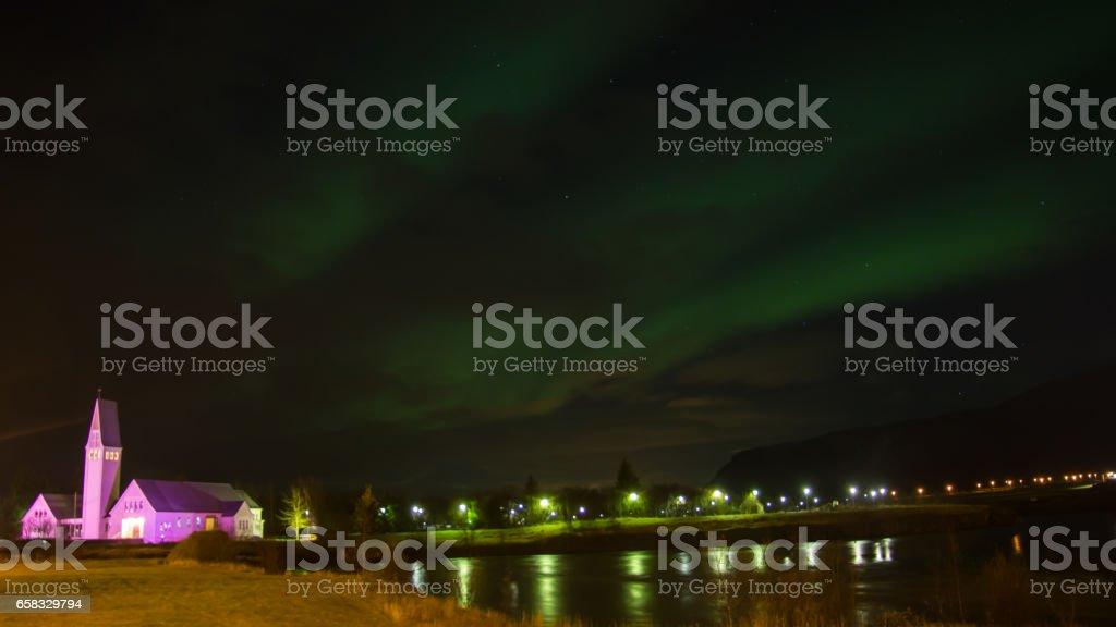 The Northern Light Aurora over Selfoss Kirk Ja Church Iceland stock photo