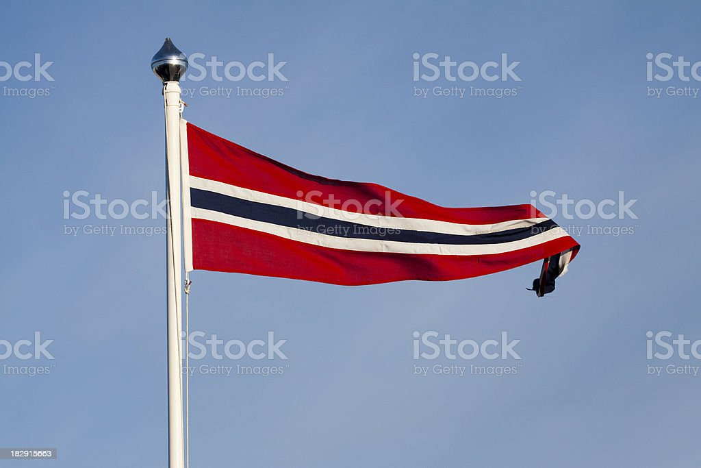 The Norwegian Flag against blue sky. royalty-free stock photo