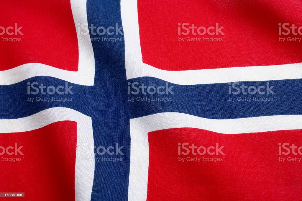 The Norwegian flag waving in the wind royalty-free stock photo