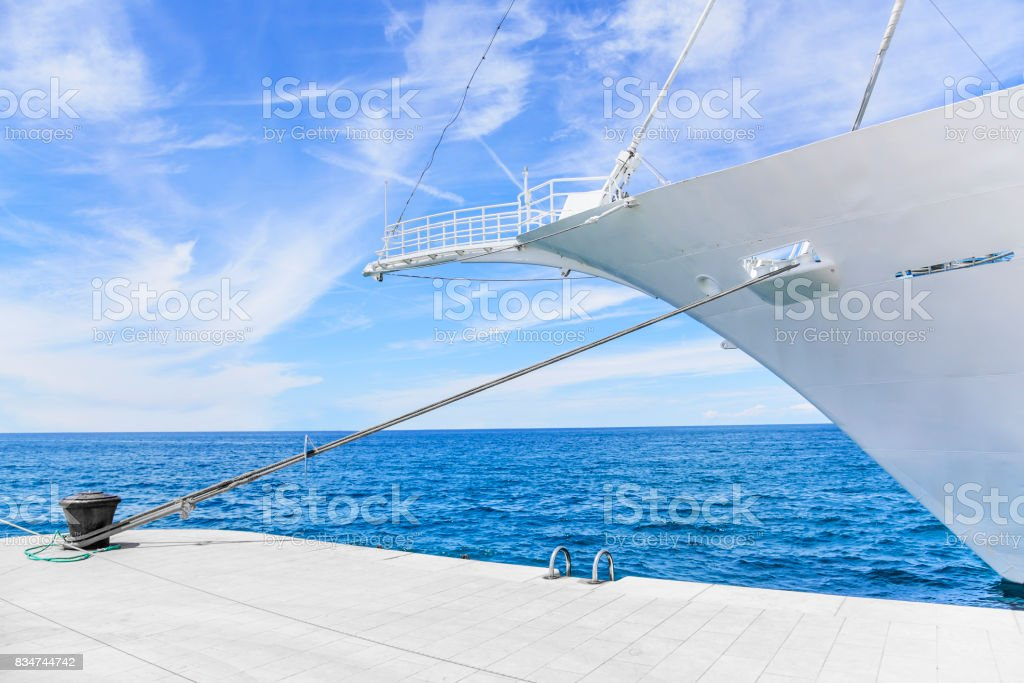 The nose of a beautiful white ship on the sea stock photo