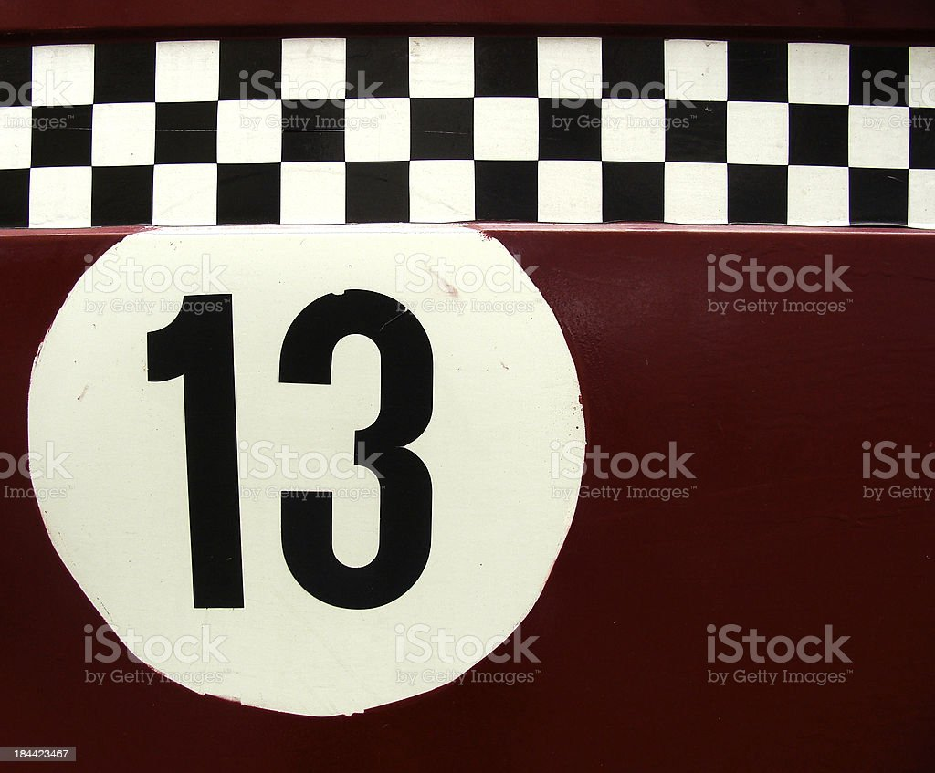 the number 13 in a race car like checker pattern stock photo