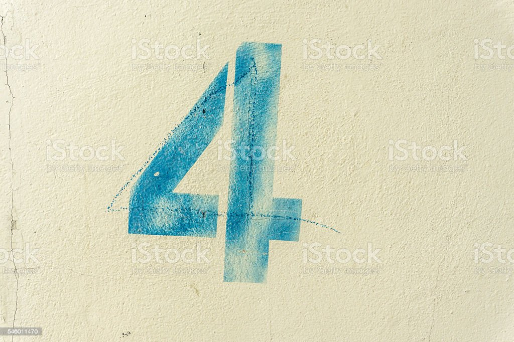 the number 4 on the dirty wall stock photo
