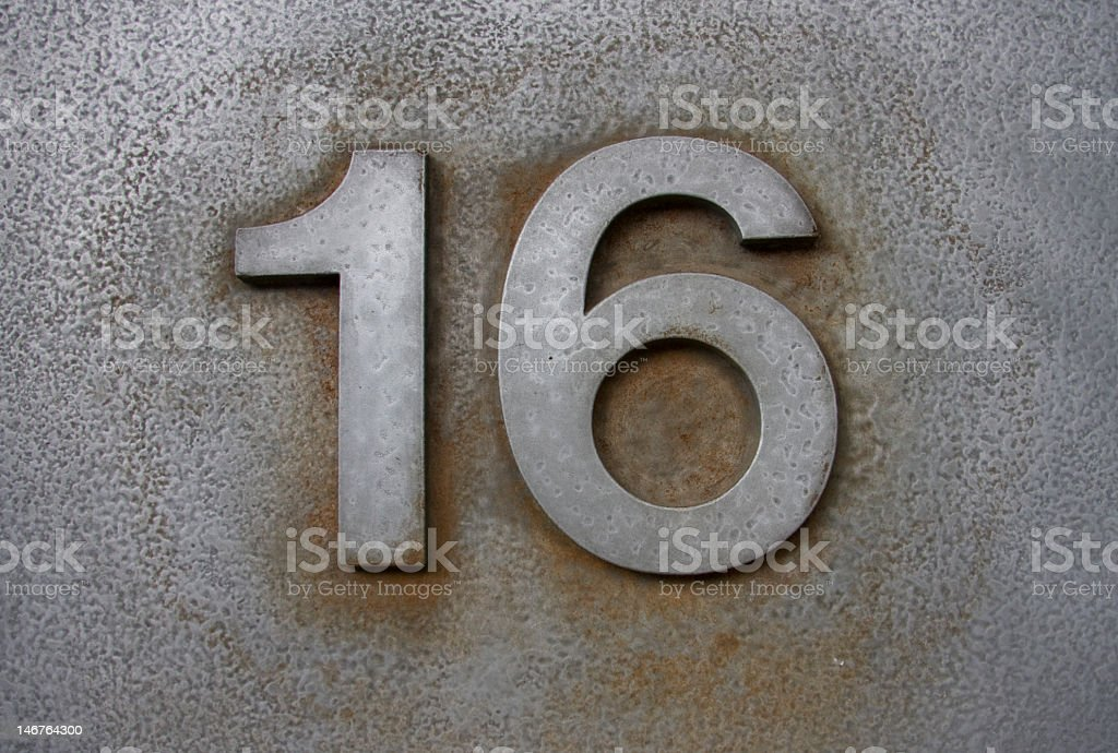 The number sixteen written in white stock photo