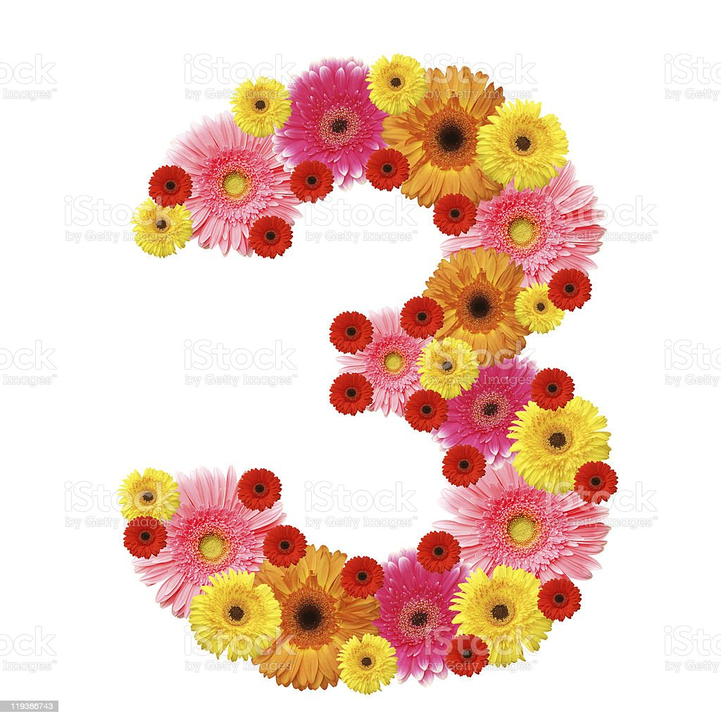 The number three made up of assorted colored sunflowers royalty-free stock photo