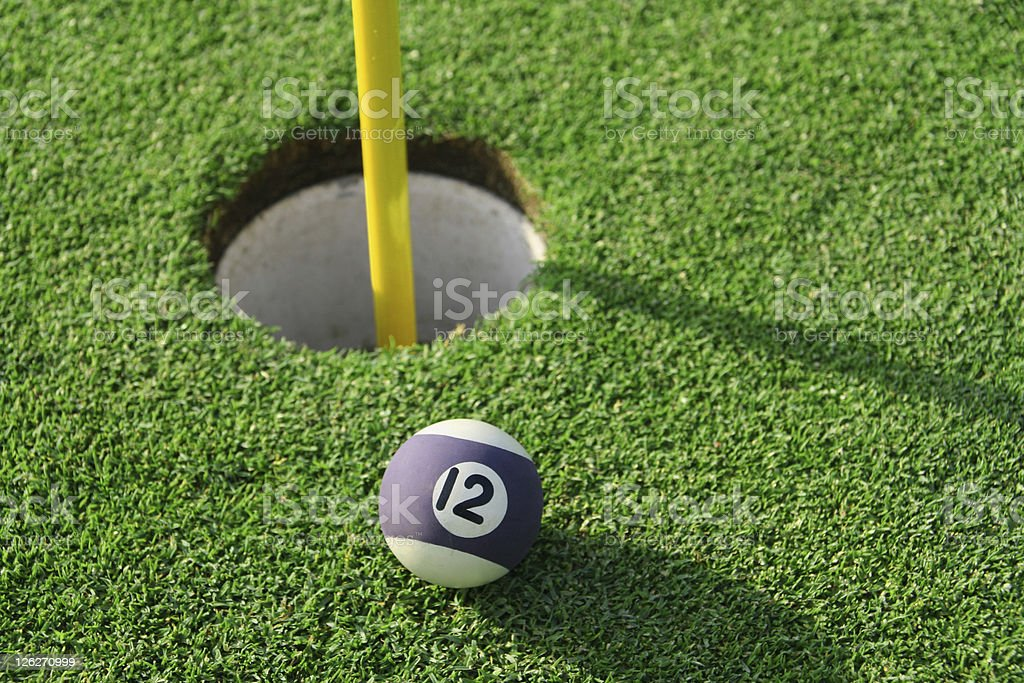 The odd ball - snooker ball on putting green