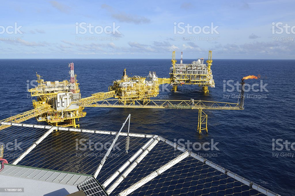 The offshore oil rig and gas flare stock photo