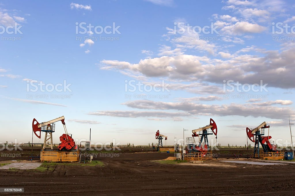 the oil pump is pumping. stock photo