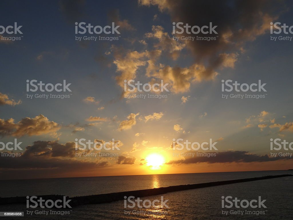 The Okinawa horizon and the setting sun stock photo
