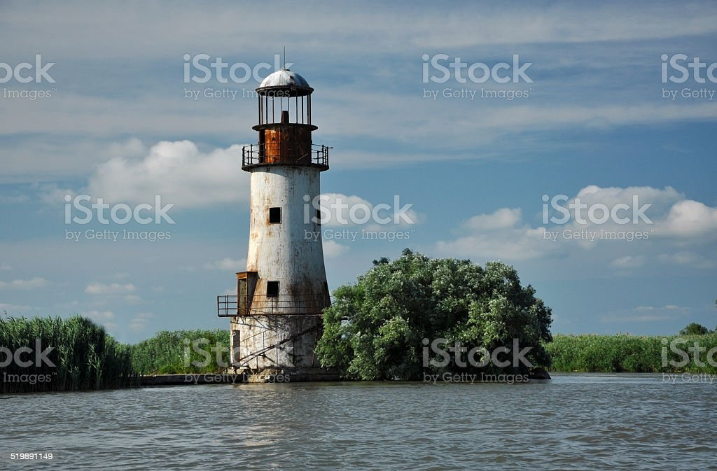 The old, abandoned lighthouse of Sulina, Danube delta stock photo