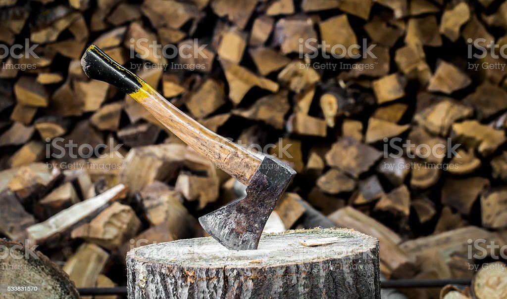 the old axe stuck in a stump stock photo