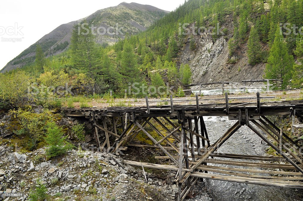 The old bridge in the mountains. stock photo