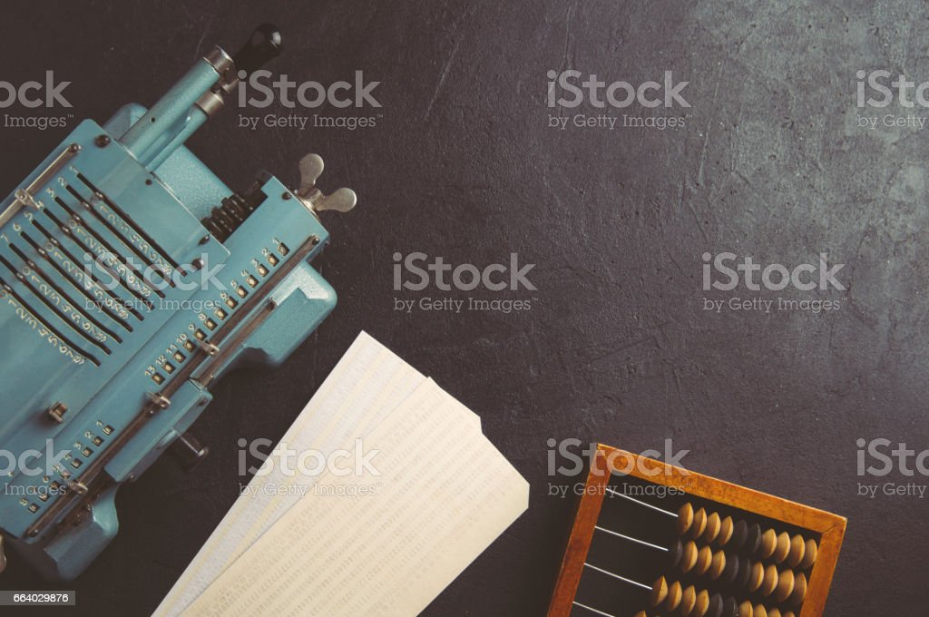 The old computing machine and wooden abacus. The concept of accounting stock photo