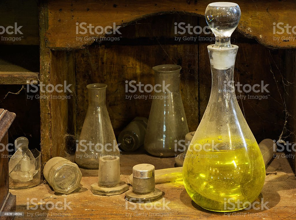 The Old decanter with a reagent on  dusty table stock photo