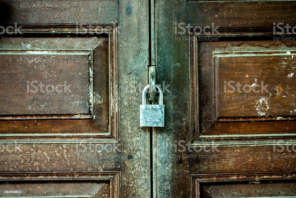 The old door with a key lock royalty-free stock photo