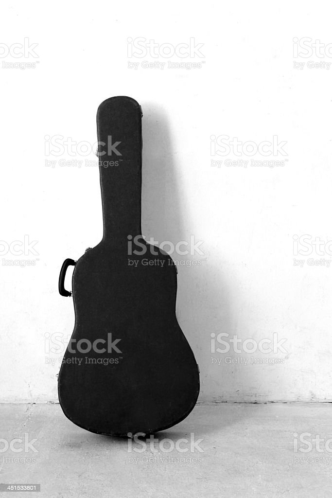 The Old Guitar case in black and white stock photo