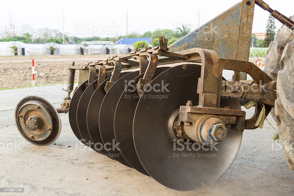 The Old Harrow Disc Plow stock photo