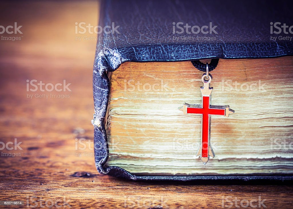 The old holy bible with metal res cross stock photo