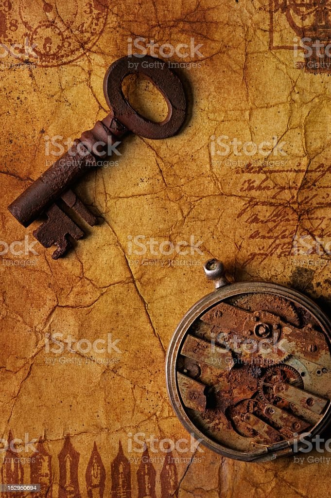 The old key with a gears on  textured paper royalty-free stock photo